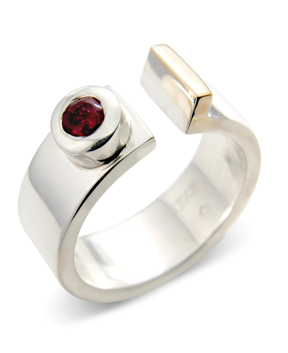 Silver ring set with ruby and 9ct gold details