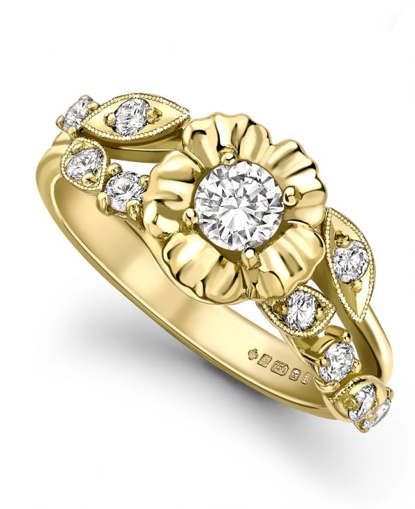 Diamond flower engagement ring set in 18ct yellow gold